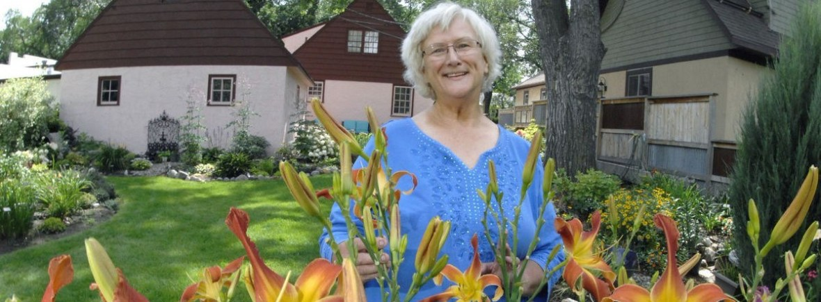 Susan Holland at Storybook Stucco Cottage Gardens. Photo by Bismarck Tribune, ND, 2017