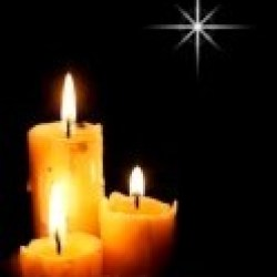 11494138-christmas-candles-with-star-light-over-black
