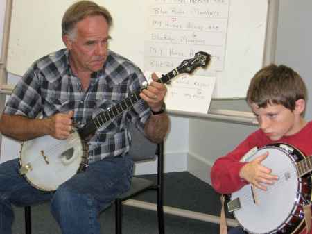 Instructor Ray Chatfield works with Ryan on Old TIme Banjo