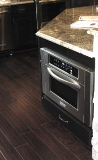 Microwave beneath countertop at Columbus Parade of Homes