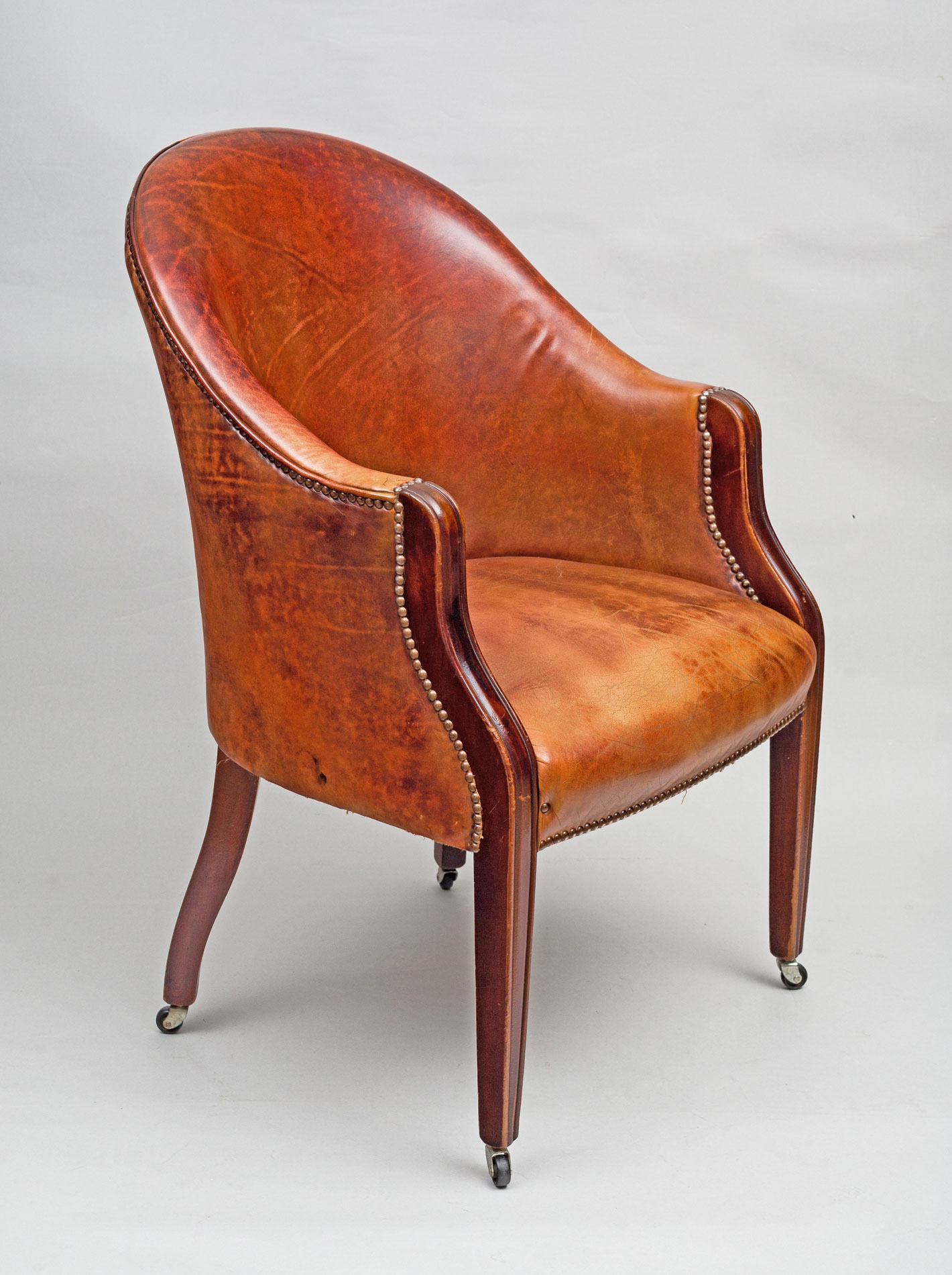 leather tub chair jessica charles chairs ottomans antique edwardian mahogany