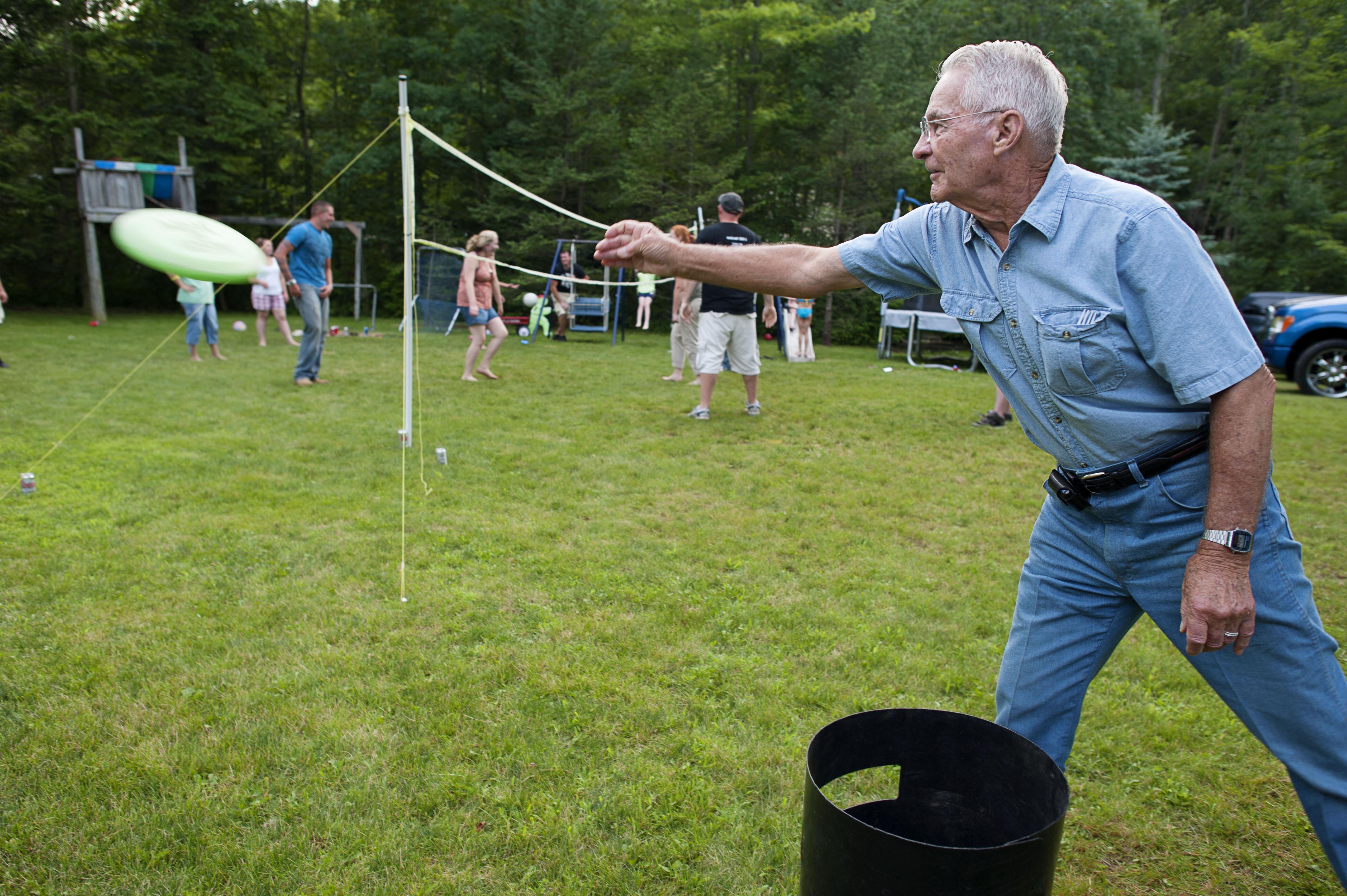 Older man playing frisbee