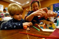 Boy and Mom work on clay sculpture