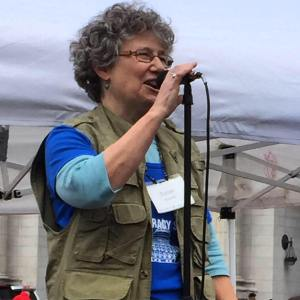 Susan Windle speaks her poem at Democracy Spring Rally, April, 2016. Photo by Jane Hulting.