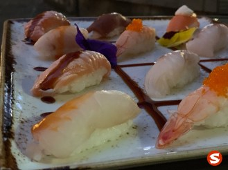sake (salmon), suzuki (sea bass), maguro (tuna back), ebi (shrimp), tai (sea bream), sake yaki (grilled salmon) nigiri