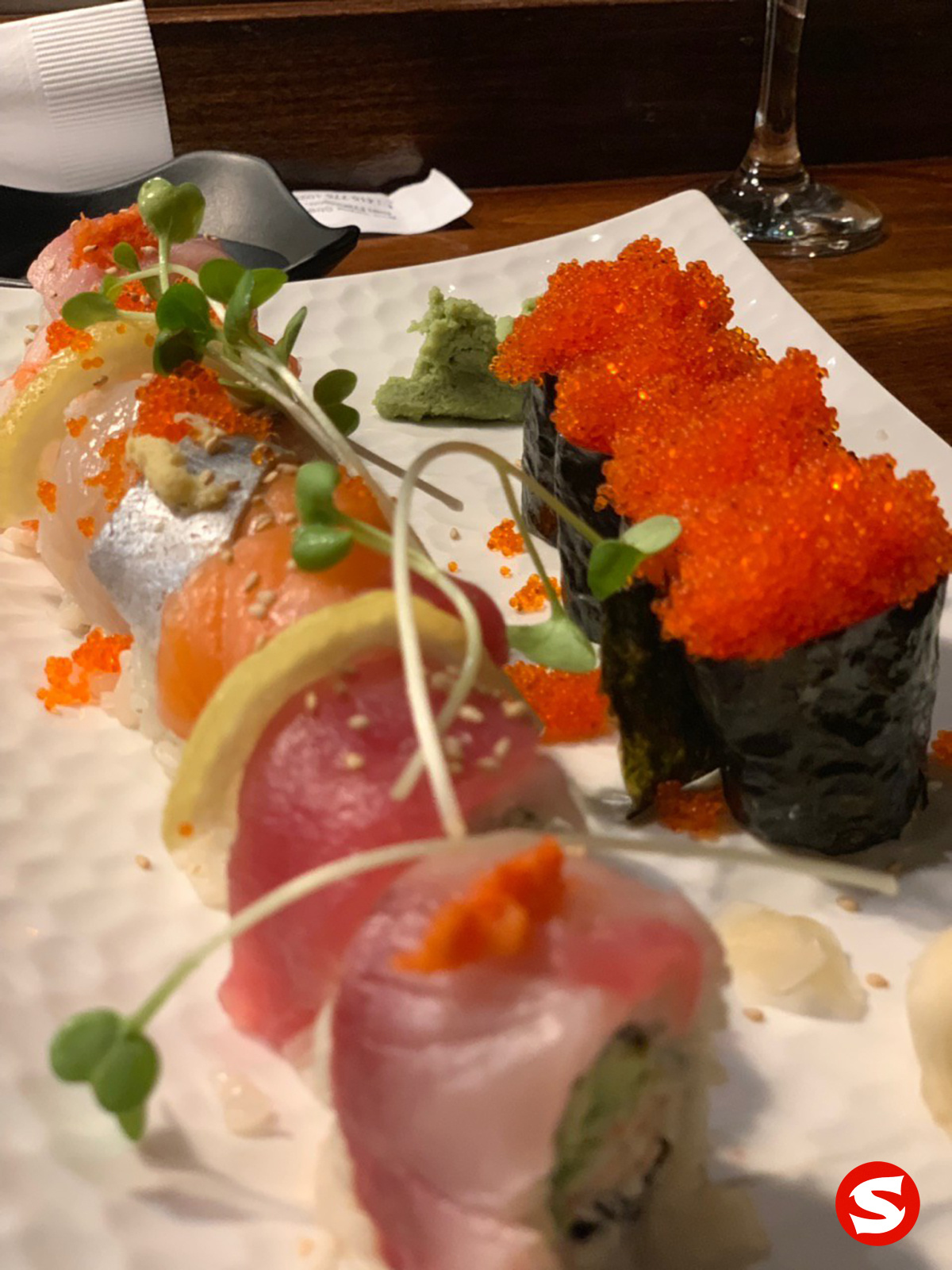 tobiko (flying fish roe) gunkan, avocado uramaki (inside out roll) with hamachi (yellowtail), ebi (shrimp), ika (squid), aji (mackerel), sake (salmon), maguro (tuna back), tai (sea bream) topping