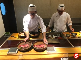 chef serving toro (fatty tuna belly) nigiri