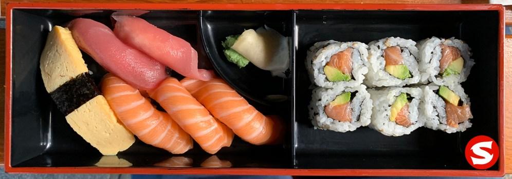 tamago (egg omelette), maguro (tuna back), sake (salmon) nigiri, sake (salmon) uramaki (inside out roll) bento box