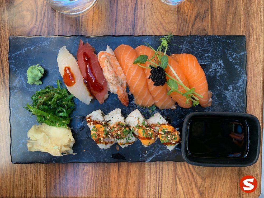 wakame and suzuki (sea bass), maguro (tuna back), ebi (shrimp), sake (salmon) nigiri, sake (salmon) uramaki (inside out roll)