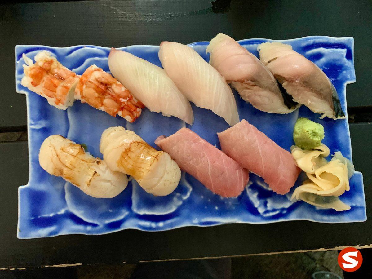 karuma ebi (Japanese imperial prawn), hamachi (yellowtail), toro (fatty tuna belly), aji (mackerel), hotategai (scallop), chu toro (medium fatty tuna belly) nigiri plate