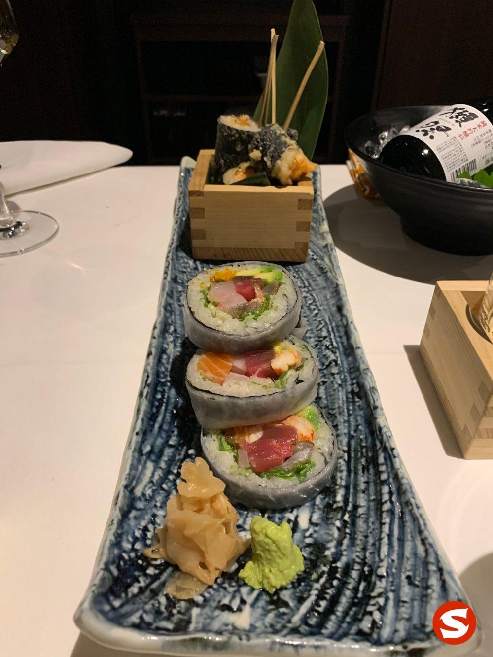 spicy sake (salmon) maki tempura (fried roll) and house roll futomaki (big roll) with maguro (tuna back), sake (salmon), hamachi (yellowtail), ebi (shrimp), kani (crab meat)