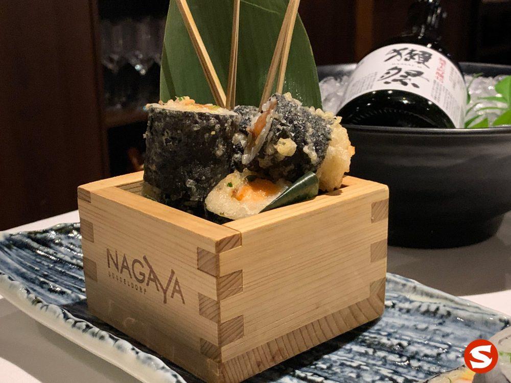 spicy sake (salmon) maki tempura (fried roll)