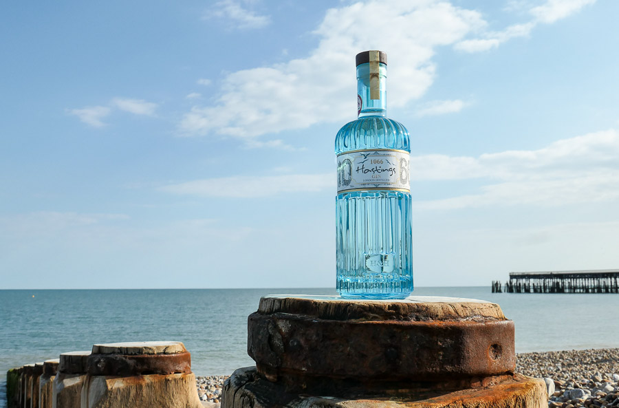 Hastings 1066 Gin bottle on beach with sea in background