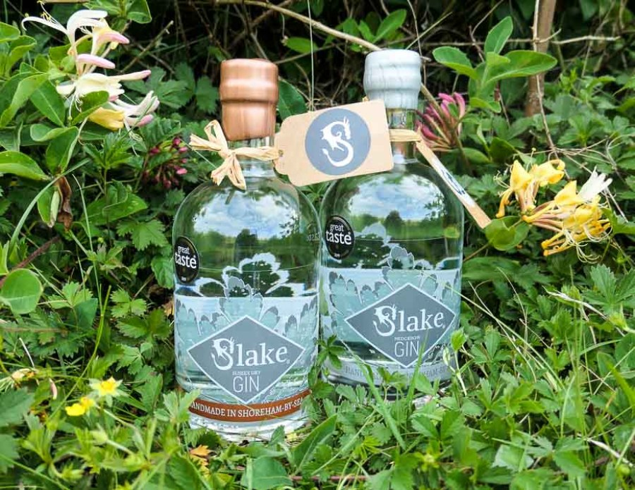Sussex Gins - two bottles of Slake Gin set in grass and honeysuckle