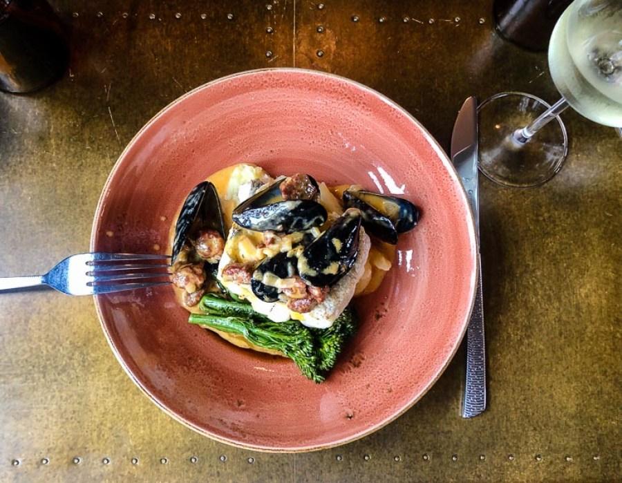 Pan-fried hake with mussels, chorizo and tender stem brocolli