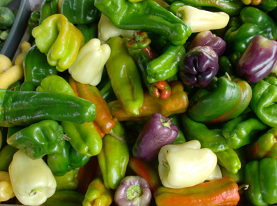 green, yellow and purple bell peppers