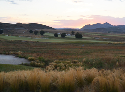 Golf course greens and putting green at sunrise