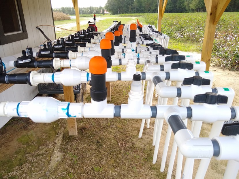 white pipe systems with orange caps