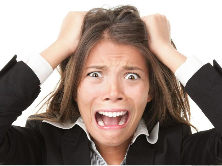 Woman showing frustration and holding on to hair