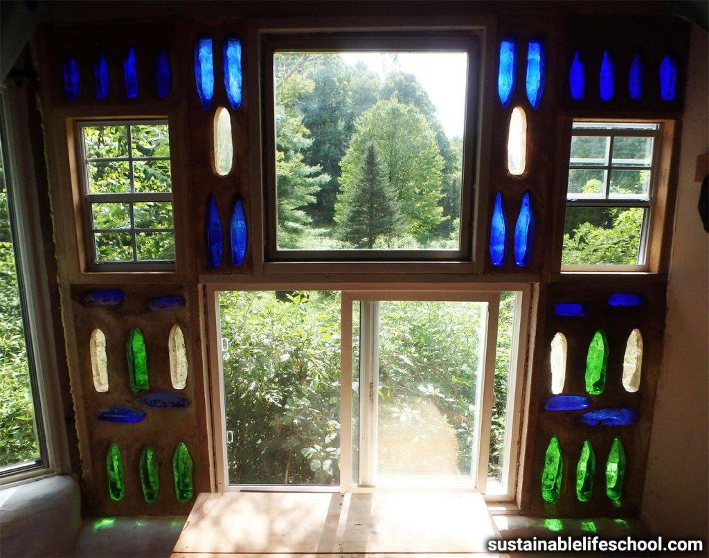 Bottle wall window in our earthbag house