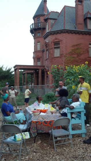 Summer evening potluck on the farm with Krueger Scott Mansion in the background