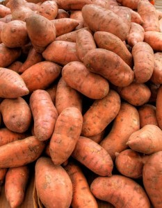 A jumble of orange sweet potatoes
