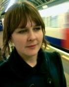 Tara Gould in a train station