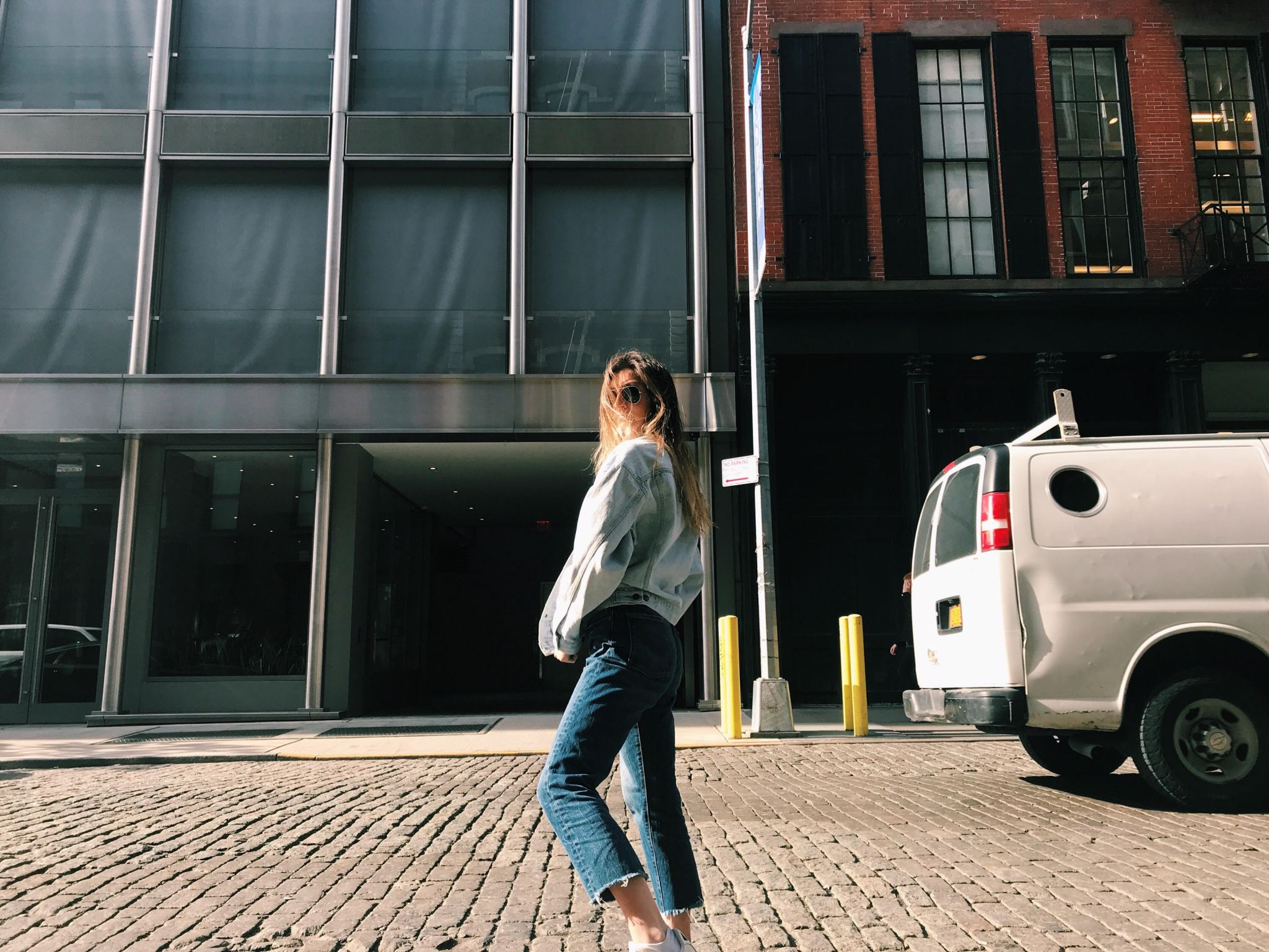 wearing jeans and jean jacket in streets of soho