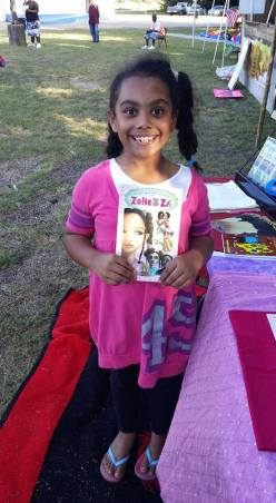 Young visitor to the market is elated to meet Zoli Zi author and get her book signed!