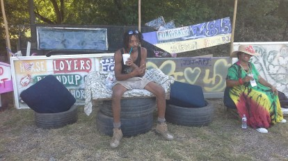 Designer and Builder of the Susu Village, Benny Walker, takes moment to cool out.