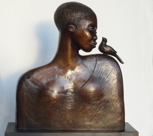 sBronze sculpture of woman with bird