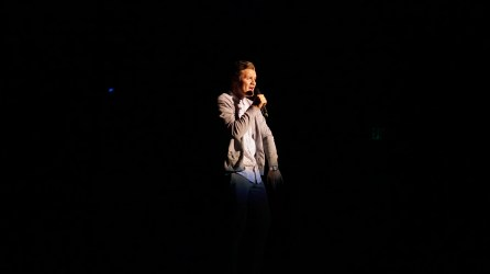 Dallin Tripp singing at Mr. SUU. Photo by Mitchell Quartz.
