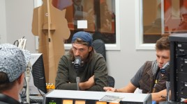 Travis Van Hoff, Van Lady Love, talking about music on Thunder 91.1. Check them out at the Red Sky Rally, Sept 30 from 5-10 p.m. Photo by Mitchell Quartz.