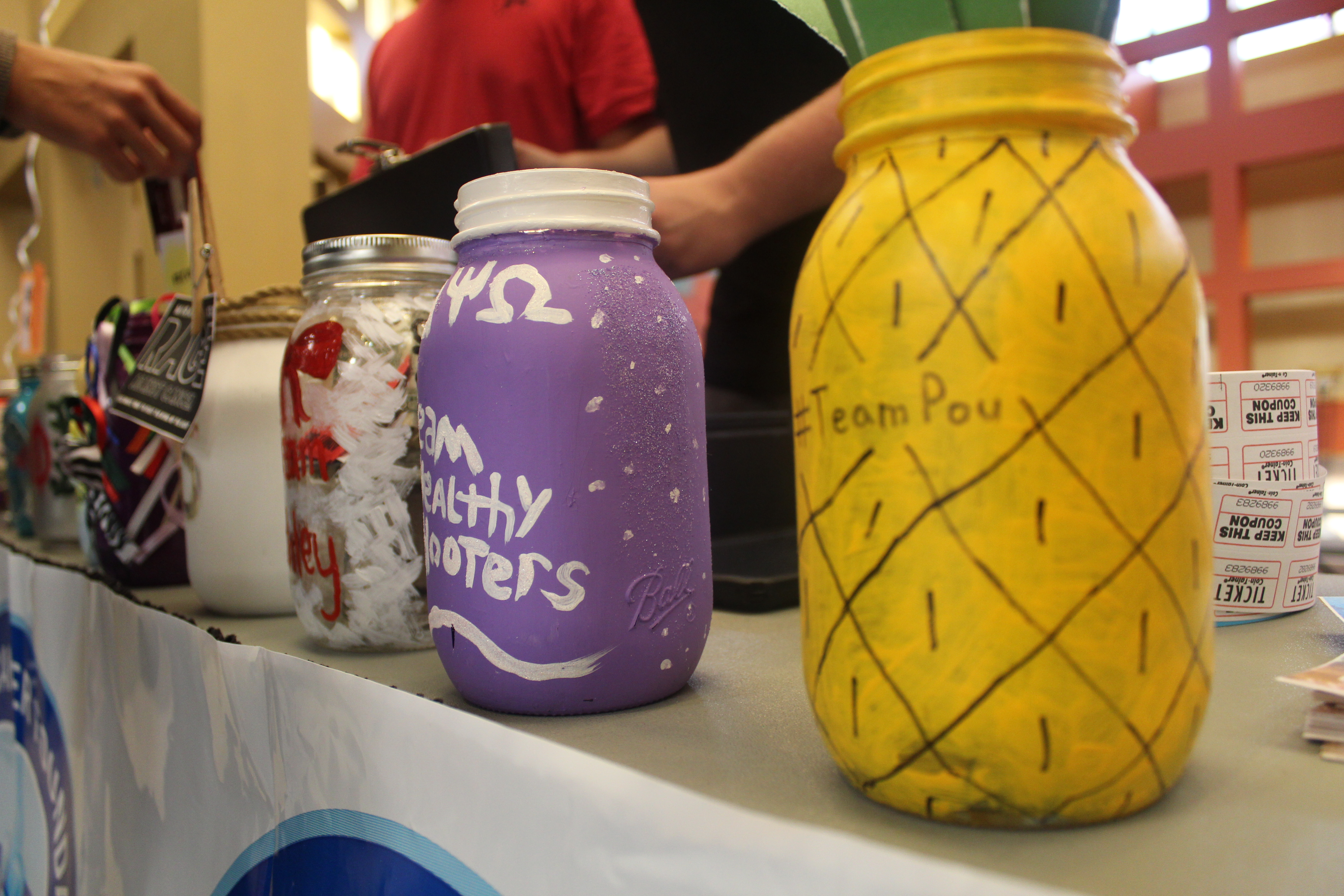 Donations for Derby Days are collected in creatively decorated jars. Photo courtesy of photo journalist Robin Nelson.