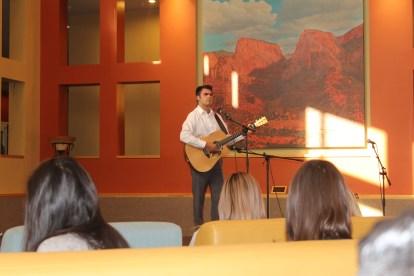 Hayden Carroll SUUSA President performs at Open Mic Night. Photo courtesy of photo journalist Robin Nelson.