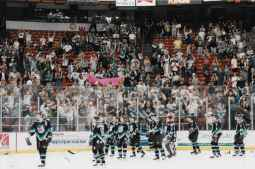 """The crowd holds up banners stating, """"Save the Thunder"""" at the team's last game in 1999. Courtesy of Brian Olsen."""