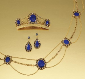 Gold, enamel, seed pearl, and lapis lazuli parure consisting of  comb, three strand necklace, and ear-bobs, circa 1810.