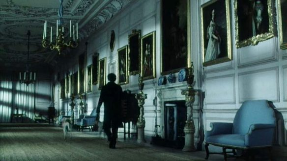 From the BBC/A&E 1995 mini-series Pride and Prejudice. Colin Firth as Mr. Darcy walks along the gallery at Pemberley.
