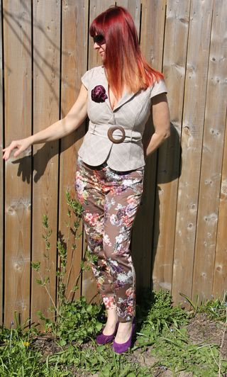 Floral pants beige jacket fence side