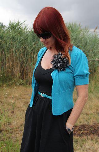 Blue sweater blue belt black dress