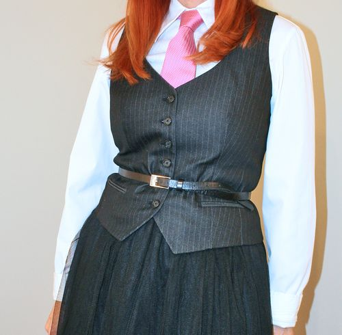 Black pin stripe vest pink tie