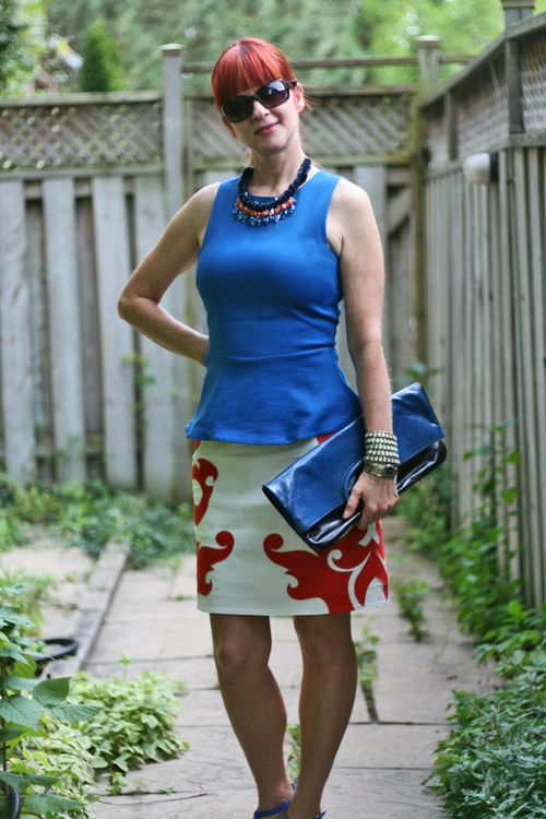 Blue peplum top white orange skirt