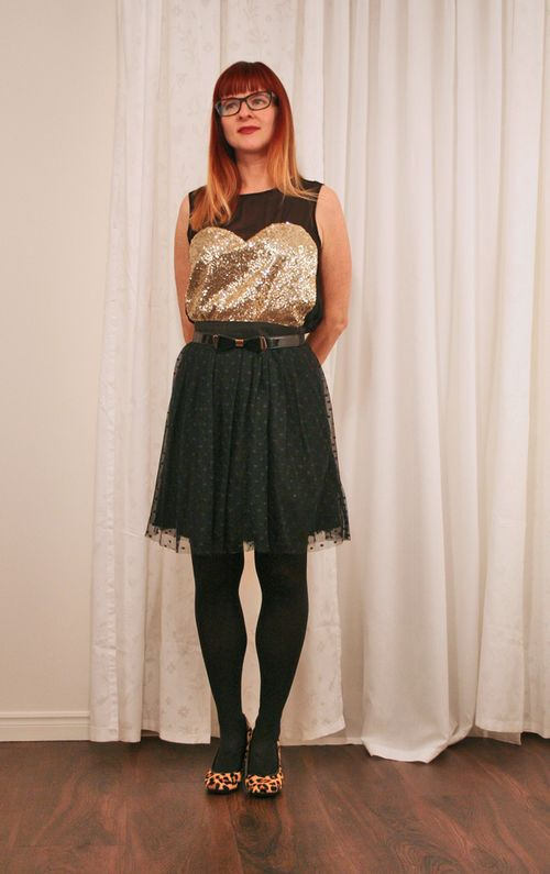 Anthropologie black tulle skirt gold sequin top Christmas party outfits idea
