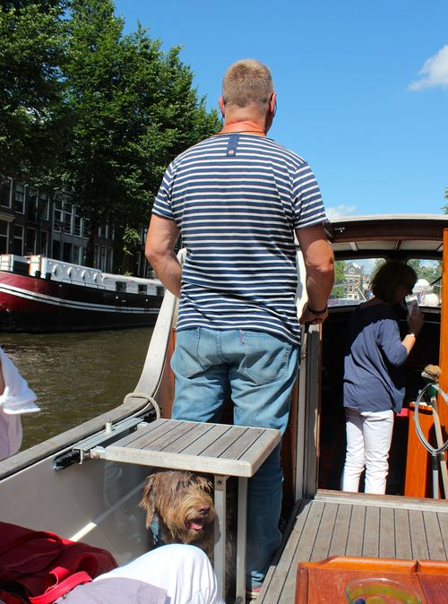 Ron with dog on canal by anja the curly traveller blog