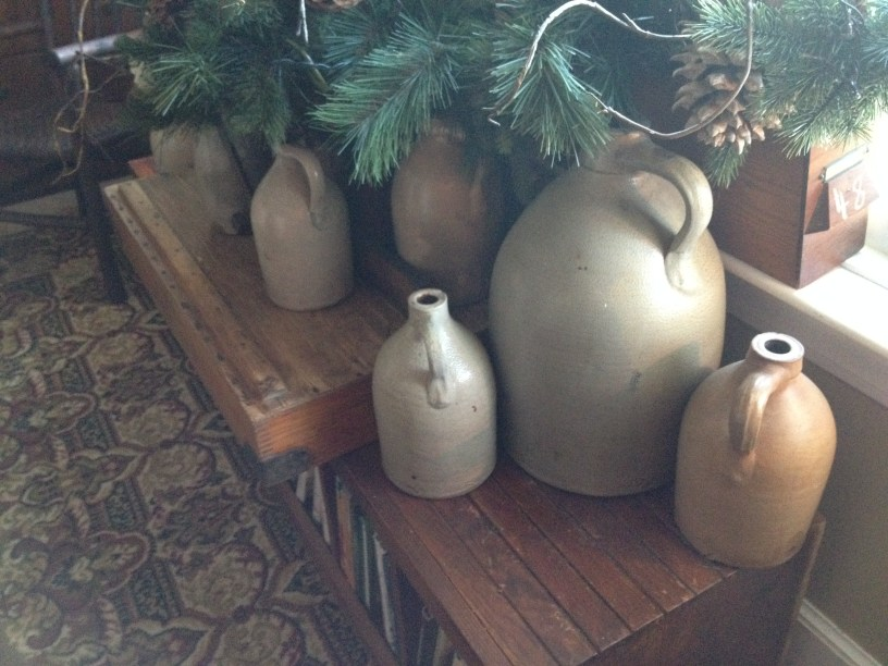 I love the shapes, textures and shadows that old jugs provide as decorating elements.