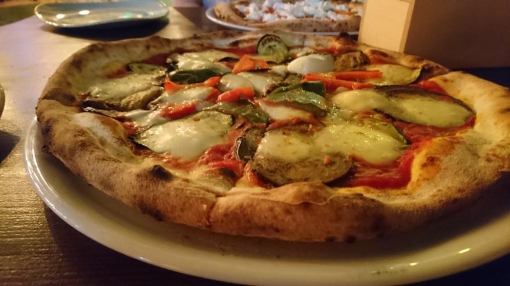 Eggplant, pepper, zucchini and mozzarella pizza