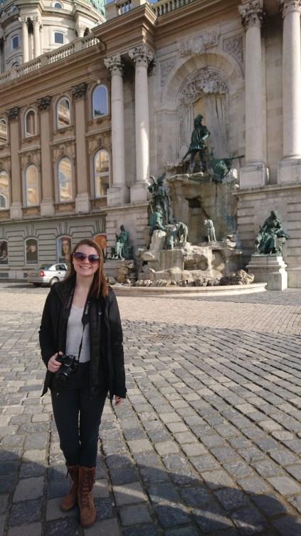 Anika in front of the fountain of King Matthias