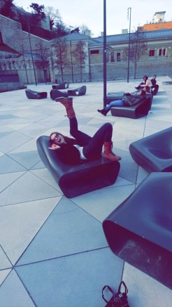 Anika being silly on some funky outdoor chairs