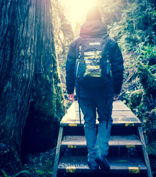 devour-cao-bc-activity-tofino-hot-springs-braden-walking-down-trail-2-edited