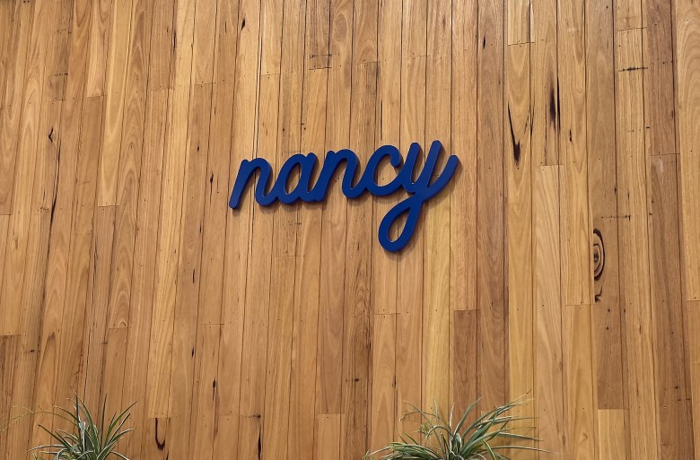Nancy cafe sign on wooden wall